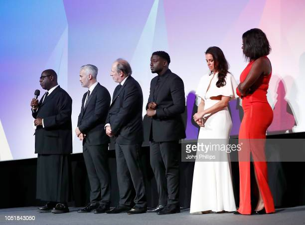 """Steve McQueen, Iain Canning, Hans Zimmer, Daniel Kaluuya, Michelle Rodriguez and Viola Davis on stage during the European Premiere of """"Widows"""" and..."""