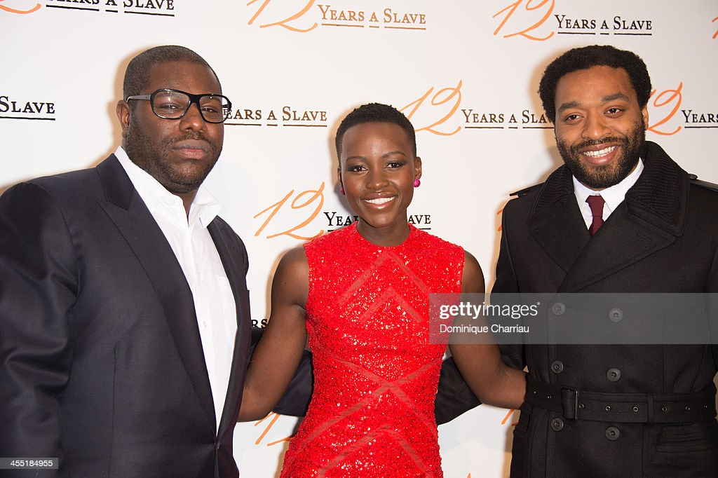 Steve McQueen; Lupita Nyong'o and Chiwetel Ejiofor attend the '12 Years A Slave' Paris premiere at Cinema UGC Normandie on December 11, 2013 in Paris, France.