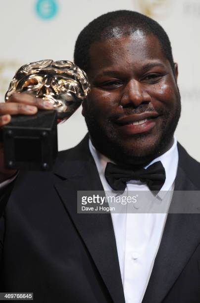 Steve McQueen poses with his Best Film in the winners room at the EE British Academy Film Awards 2014 at The Royal Opera House on February 16, 2014...
