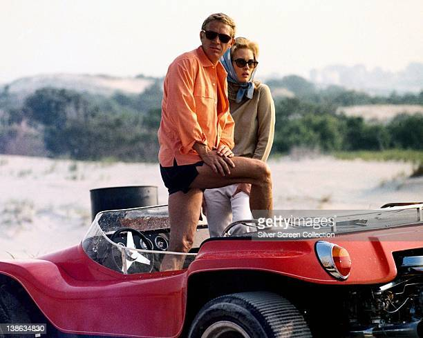 Steve McQueen US actor and Faye Dunaway US actress posing in an opentop car in a publicity image issued for the film 'The Thomas Crown Affair' USA...