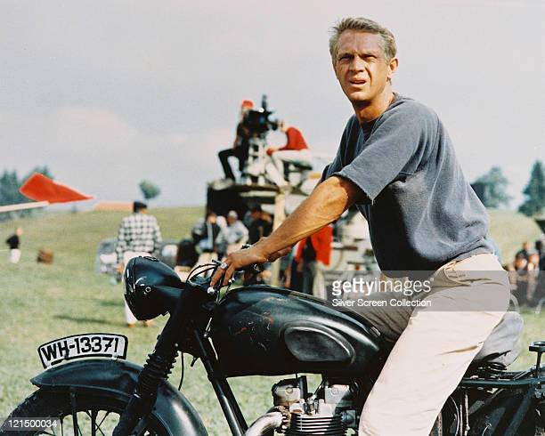 Steve McQueen US actor sitting astride a motorcycle in a publicity still issued for the film 'The Great Escape' 1963 The prisoner of war drama...