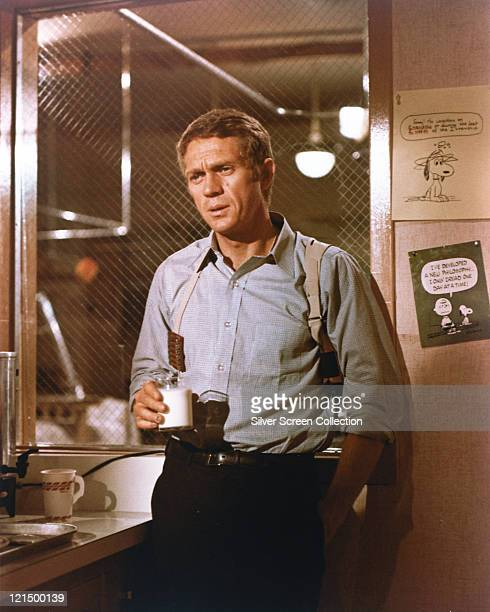 Steve McQueen , US actor, wearing a blue shirt and holding a white mug in a publicity still issued for the film, 'Bullitt', 1968. The crime drama,...