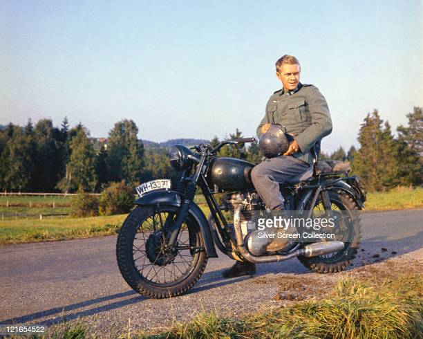 Steve McQueen , US actor, wearing a German military uniform, sitting astride a motorcycle in a publicity still issued for the film, 'The Great...