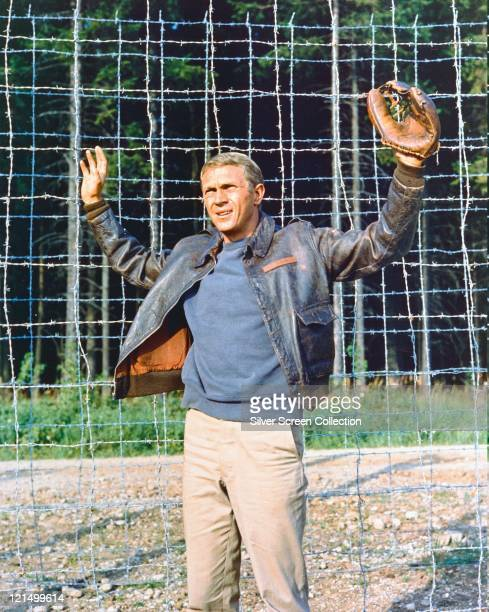 Steve McQueen US actor wearing a leather jacket and a baseball glove with his hands held up in submission in a publicity still issued for the film...