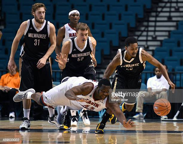 Steve McWhorter of the Milwaukee Panthers steals the ball from J.J. Davenport of the Louisiana-Lafayette Ragin' Cajuns as Matt Tiby and Alex Prahl of...
