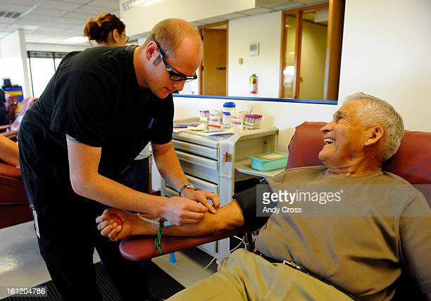 GOLDEN CO Steve Medina 85yearsold from Lakewood Colorado right has a laugh with Bonfils Blood Center apheresis tech Derek Heyl who was prepping...