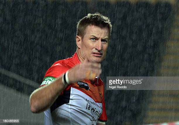 Steve Menzies of Catalan Dragons looks on through the rain during warmups before the Super League Play Off between Hull FC and Catalan Dragons at the...