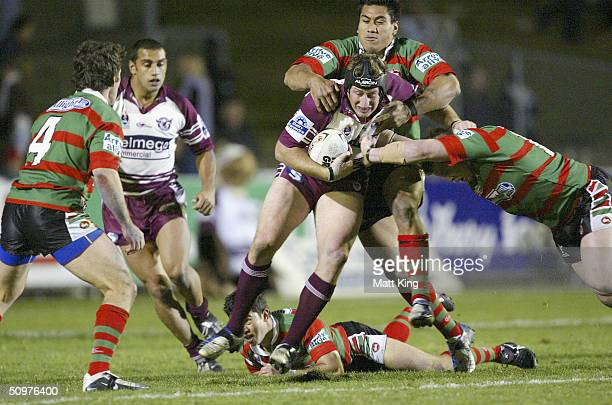Steve Menzies of the Sea Eagles is tackled by the Rabbitohs defence during the round 15 NRL match between the Manly Sea Eagles and the South Sydney...