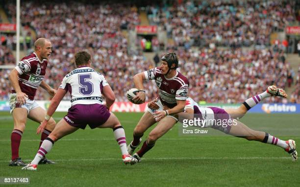 Steve Menzies of the Sea Eagles offloads the ball during the NRL Grand Final match between the Manly Warringah Sea Eagles and the Melbourne Storm at...
