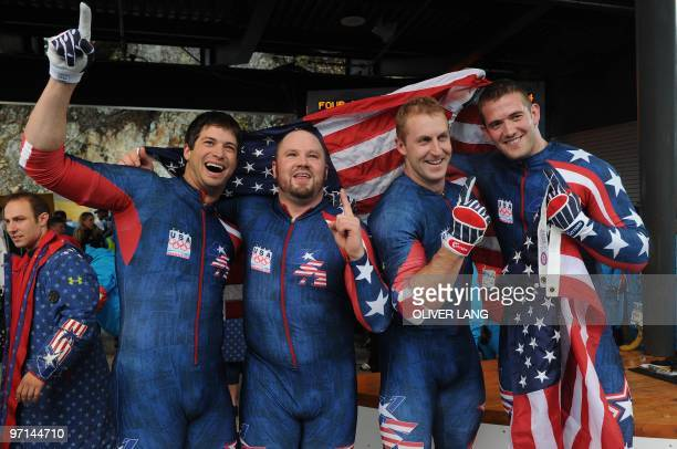 Steve Mesler Steven Holcomb Curtis Tomasevicz and Justin Olsen of the USA1 fourman bobsleigh team celebrate winning gold in the 4man bobsleigh event...