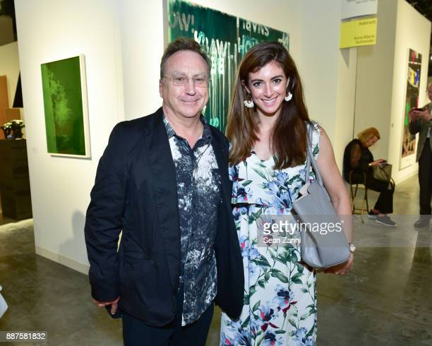 Steve Miller and Colleen Stellato attend Art Basel Miami Beach Private Day at Miami Beach Convention Center on December 6 2017 in Miami Beach Florida