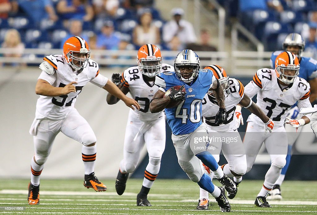 Steve Miller #40 of the Detroit Lions runs for a first down during the preseason game against the Cleveland Browns at Ford Field on August 9, 2014 in Detroit, Michigan. The Lions defeated the Browns 13-12.