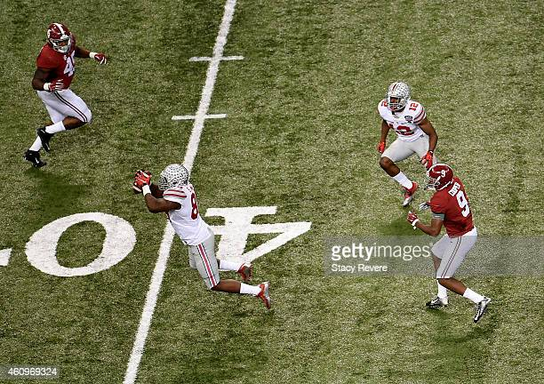 Steve Miller of the Ohio State Buckeyes socres a 41 yard interception return from Blake Sims of the Alabama Crimson Tide in the third quarter during...