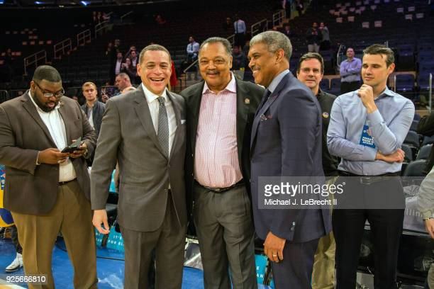 Steve Mills and Jesse Jackson look on prior to the game between the Golden State Warriors and New York Knicks on February 26 2018 at Madison Square...
