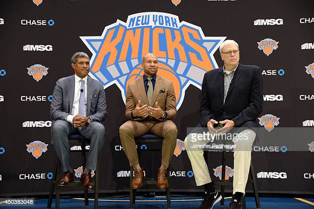 Steve Mills Derek Fisher and Phil Jackson during the press conference to announce Derek Fisher as head coach of the New York Knicks on June 10 2014...
