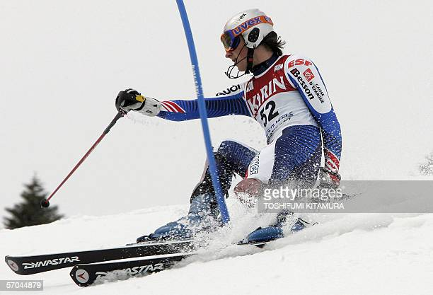 Steve Missillier of France goes out of the slalom course after loosing his balance in his second run during the 9th Men's Slalom competition at Shiga...