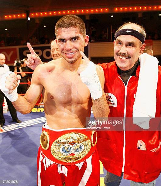 Steve Molitor of Canada celebrates his win against Michael Hunter of Great Britain during the IBF Super Bantamweight Crown at Borough Hall on...