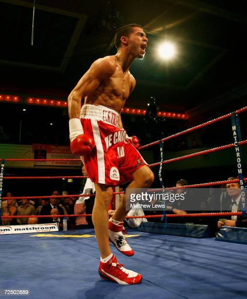 Steve Molitor of Canada celebrates his win over Michael Hunter of Great Britain during the IBF Super Bantamweight Crown at Borough Hall on November...