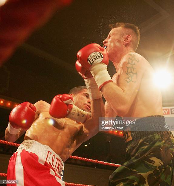 Steve Molitor of Canada lands a punch on Michael Hunter of Great Britain during the IBF Super Bantamweight Crown at Borough Hall on November 10, 2006...