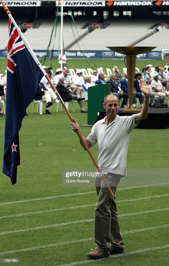 Steve Moneghetti is a flag bearer during the 50th anniversary of the 1956 Melbourne Olympic Games at the Melbourne Cricket Ground November 19, 2006 in Melbourne, Australia.