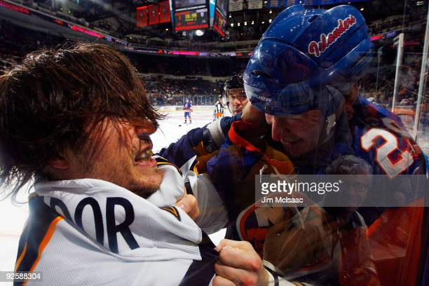 Steve Montador of the Buffalo Sabres battles Brendan Witt of the New York Islanders during their second period fight on October 31 2009 at Nassau...