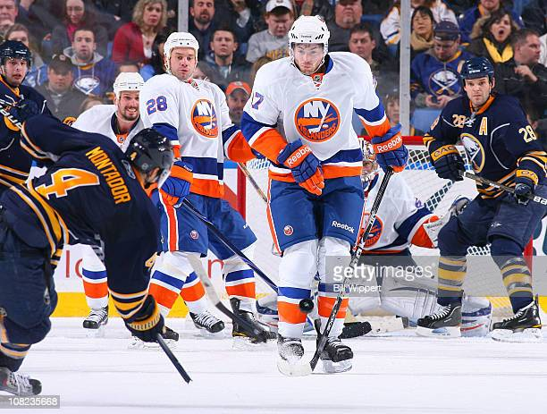 Steve Montador of the Buffalo Sabres breaks his stick on a shot blocked by Jeremy Colliton of the New York Islanders at HSBC Arena on January 21 2011...