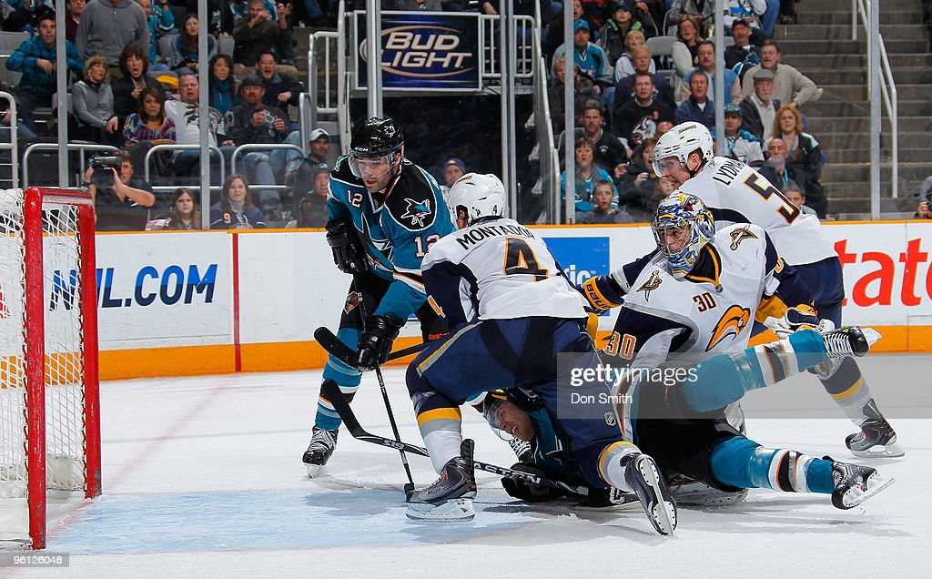 Steve Montador #4, Ryan Miller #30 and Toni Lydman #5 of the Buffalo Sabres watch as Joe Pavelski #8 of the San Jose Sharks taps the puck in the net by teammate Patrick Marleau #12 during an NHL game on January 23, 2010 at HP Pavilion at San Jose in San Jose, California.
