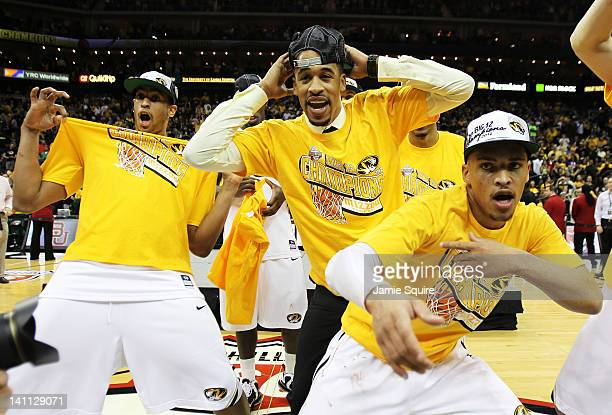 Steve Moore, Michael Dixon and Laurence Bowers of the Missouri Tigers celebrates with teammates after they defeated the Baylor Bears 90 to 75 to win...