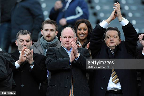 Steve Morgan the owner and chairman of Wolverhampton Wanderers and Jez Moxey the CEO of Wolverhampton Wanderers celebrate at full time