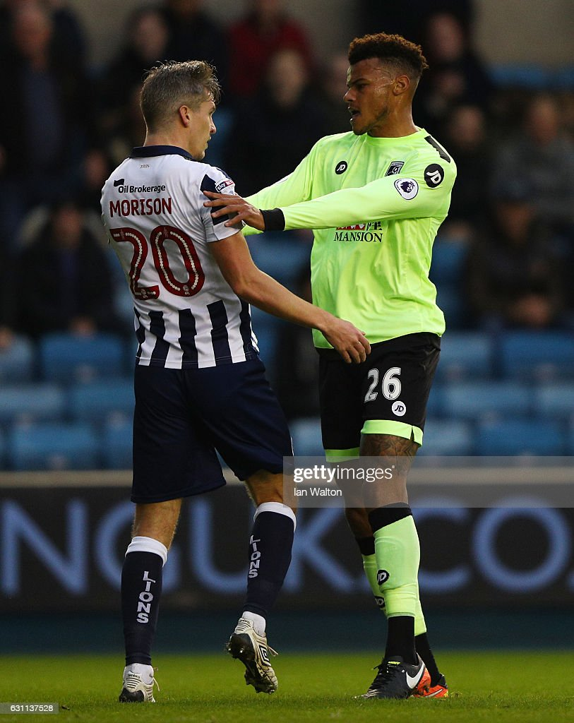 Steve Morison of Millwall and Tyrone Mings of AFC Bournemouth clash during the Emirates FA Cup third round match between Millwall and AFC Bournemouth at The Den on January 7, 2017 in London, England.