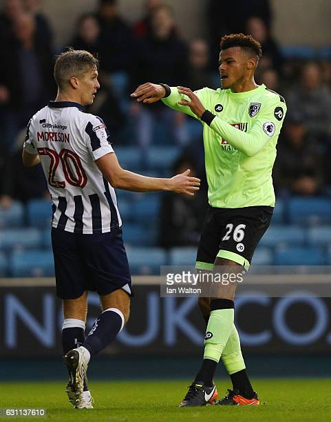 Steve Morison of Millwall and Tyrone Mings of AFC Bournemouth clash during the Emirates FA Cup third round match between Millwall and AFC Bournemouth...