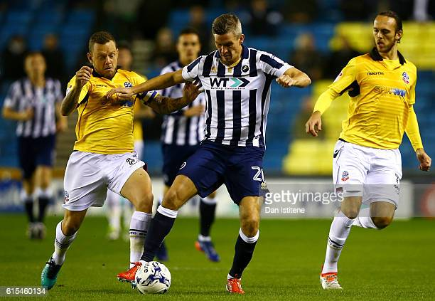 Steve Morison of Millwall battles for the ball with Jay Spearing of Bolton Wanderers during the Sky Bet League One match between Millwall and Bolton...