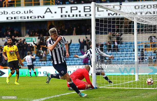 Steve Morison of Millwall celebrates scoring his sides first goal during The Emirates FA Cup Fourth Round match between Millwall and Watford at The...