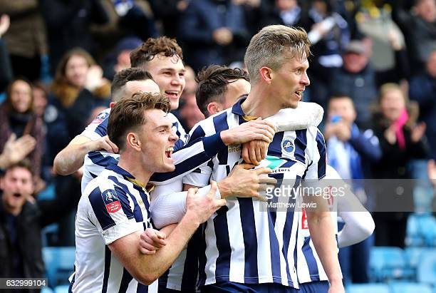 Steve Morison of Millwall celebrates scoring his sides first goal with his Millwall team mates during The Emirates FA Cup Fourth Round match between...