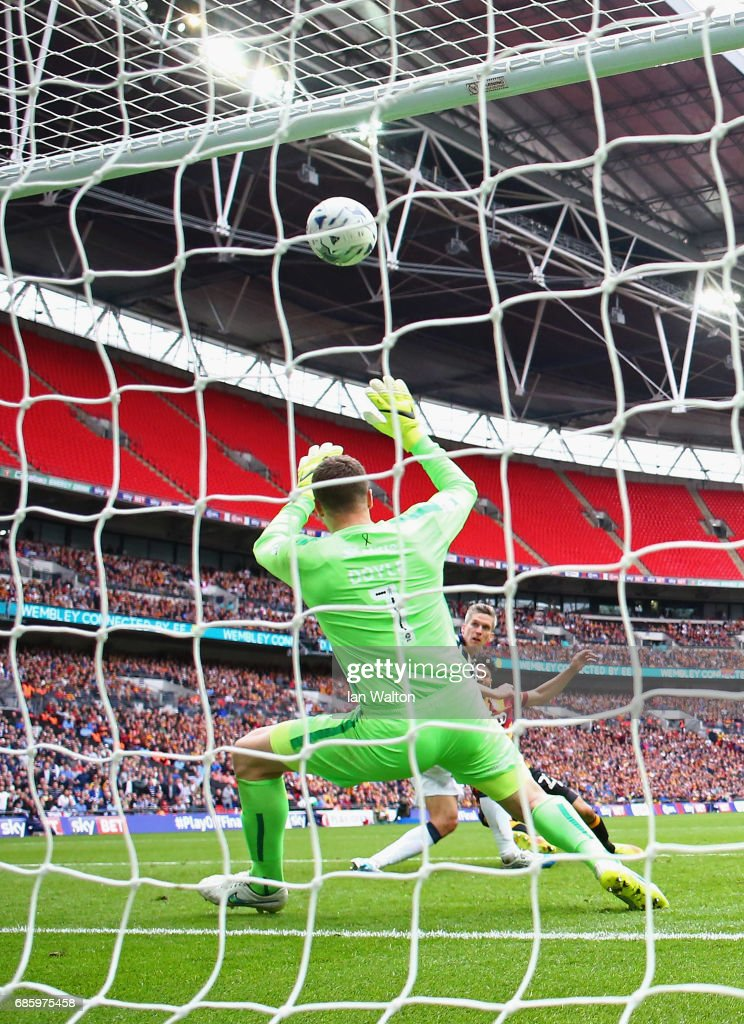Steve Morison of Millwall (C) shoots past goalkeeper Colin Doyle of Bradford City as he scores their first goal during the Sky Bet League One Playoff Final between Bradford City and Millwall at Wembley Stadium on May 20, 2017 in London, England.