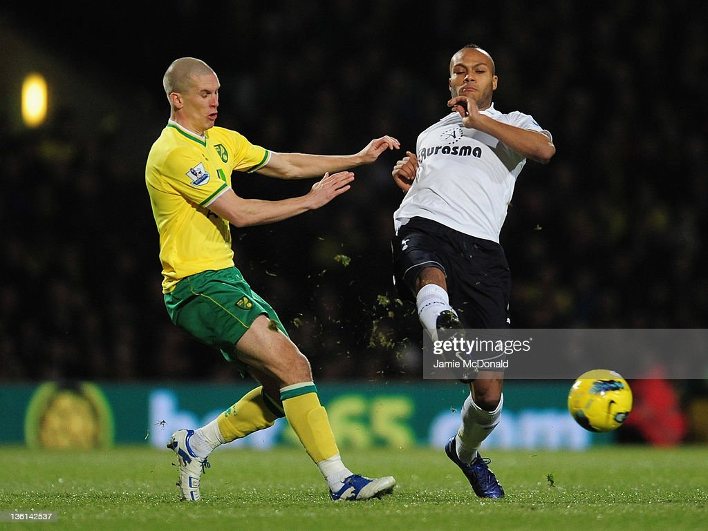 Steve Morison of Norwich City and Younes Kaboul of Spurs battle for the ball during the Barclays Premier Leauge match between Norwich City and Tottenham Hotspur at Carrow Road on December 27, 2011 in Norwich, England.