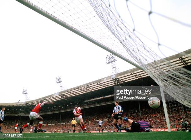 Steve Morrow of Arsenal scores past Sheffield Wednesday goalkeeper Chris Woods during the Coca-Cola League Cup Final between Arsenal and Sheffield...
