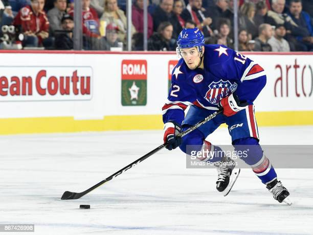 Steve Moses of the Rochester Americans skates the puck against the Laval Rocket during the AHL game at Place Bell on October 25 2017 in Laval Canada...