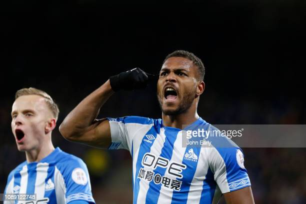GOAL Steve Mounie celebrates scoring the opening goal during the Premier League match between Huddersfield Town and Burnley FC at John Smith's...