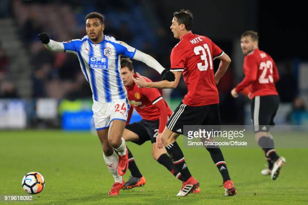 Steve Mounie of Huddersfield battles with Nemanja Matic of Man Utd during The Emirates FA Cup Fifth Round match between Huddersfield Town and...