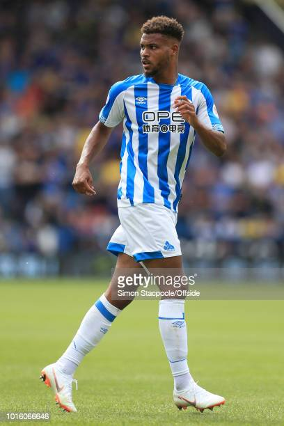 Steve Mounie of Huddersfield looks on during the Premier League match between Huddersfield Town and Chelsea at the John Smith's Stadium on August 11...