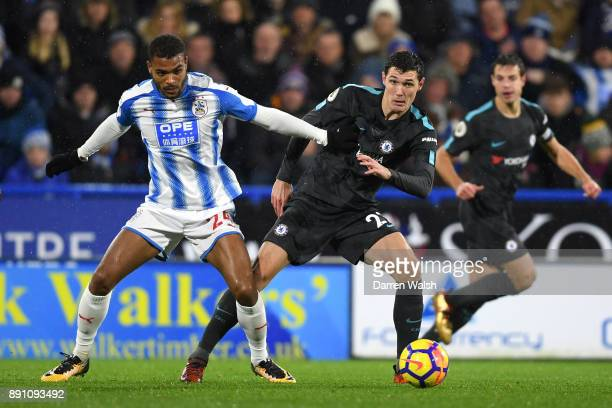 Steve Mounie of Huddersfield Town and Andreas Christensen of Chelsea during the Premier League match between Huddersfield Town and Chelsea at John...