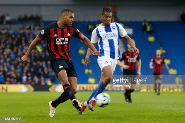 Steve Mounie of Huddersfield Town and Bernardo of Brighton Hove Albion during the Premier League match between Brighton Hove Albion and Huddersfield...