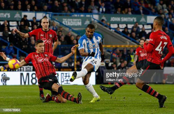Steve Mounie of Huddersfield Town and Jan Bednarek Yan Valery and Oriol Romeu of Southampton during the Premier League match between Huddersfield...