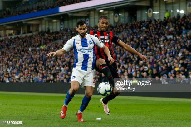 Steve Mounie of Huddersfield Town and Martin Montoya of Brighton Hove Albion during the Premier League match between Brighton Hove Albion and...
