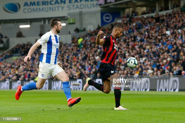 Steve Mounie of Huddersfield Town and Shane Duffy of Brighton Hove Albion during the Premier League match between Brighton Hove Albion and...