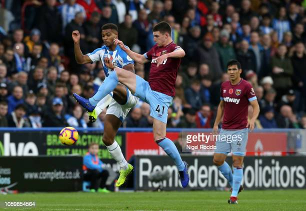 Steve Mounie of Huddersfield Town battles for possession with Declan Rice of West Ham United during the Premier League match between Huddersfield...