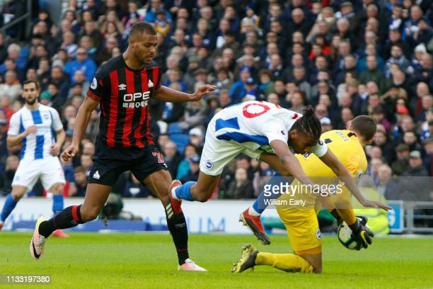 Steve Mounie of Huddersfield Town Bernardo and Matthew Ryan of Brighton Hove Albion during the Premier League match between Brighton Hove Albion and...