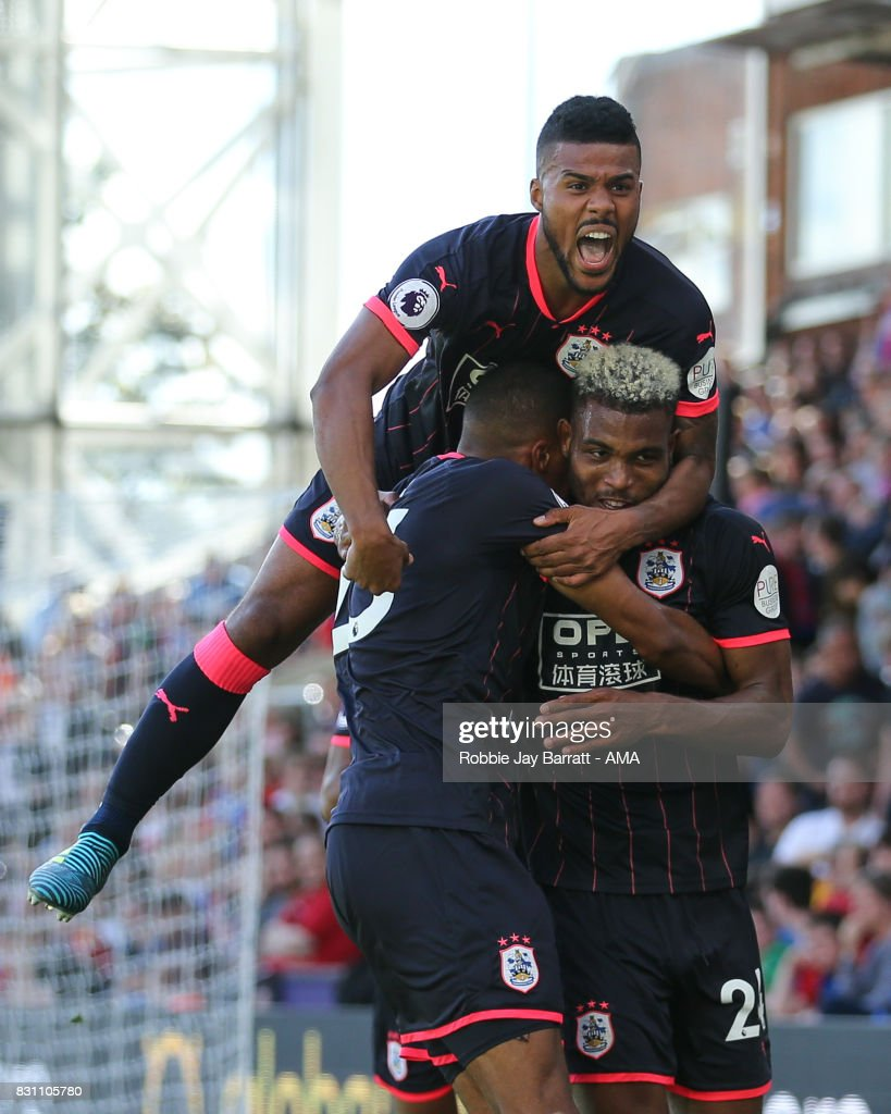 Steve Mounie of Huddersfield Town celebrates after scoring a goal to make it 0-3 during the Premier League match between Crystal Palace and Huddersfield Town at Selhurst Park on August 12, 2017 in London, England.