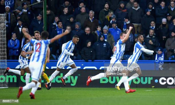 Steve Mounie of Huddersfield Town celebrates after scoring his sides first goal during the Premier League match between Huddersfield Town and...
